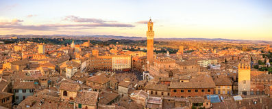 Siena sunset skyline. Mangia tower landmark. Italy. Siena aerial sunset panoramic skyline. Mangia tower and Campo square landmark. Tuscany, Italy Royalty Free Stock Photography