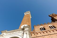 Siena tower against a clear blue sky stock photo