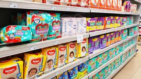 Supermarket shelves with baby products: diapers stock images