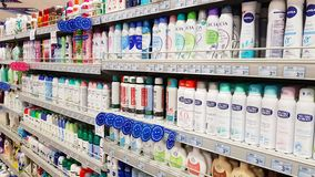 Supermarket shelves with products for personal hygiene: deodorants, perfumes, soap royalty free stock images