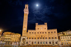 Siena, Tuscany, Italy: the town hall Palazzo Pubblico in Piazza del Campo Stock Photo