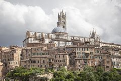 Sienna, Cathedral Cattedrale di Santa Maria Assunta with old town, Tuscany, Italy Stock Image