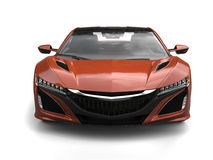 Sienna colored modern sports concept car - front view closeup shot Stock Images