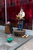 Sierpień 4th, 2017, korek, Irlandia - uliczny wykonawca na St Patrick ulicie Fotografia Royalty Free
