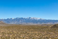Sierra Blanca Mountains, New Mexico. Looking at the snowcapped Sierra Blanca mountains in New Mexico, from Three Rivers Petroglyph Recreational Site royalty free stock images