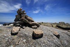 Sierra de Bejar mountains. Scenic landscape of Sierra de Bejar mountains with rock cairn in foreground, Spain Royalty Free Stock Images
