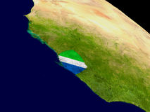 Sierra Leone with flag on Earth Stock Image