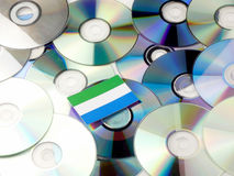 Sierra Leone flag on top of CD and DVD pile isolated on white. Sierra Leone flag on top of CD and DVD pile isolated Royalty Free Stock Photos