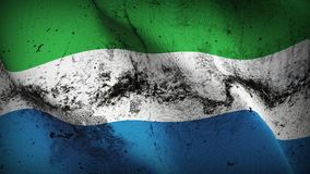 Sierra Leone grunge dirty flag waving on wind. Sierra Leonean background fullscreen grease flag blowing on wind. Realistic filth fabric texture on windy day Royalty Free Stock Photography