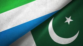 Sierra Leone and Pakistan two flags textile cloth, fabric texture royalty free stock image