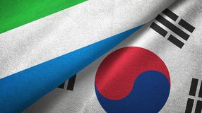 Sierra Leone and South Korea two flags textile cloth, fabric texture. Sierra Leone and South Korea flags together textile cloth, fabric texture stock photo