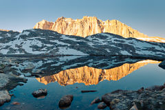 Sierra Nevada Alpenglow Reflection. Mount Hitchcock mirrors in a lake at sunrise Stock Photography