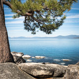 Sierra Nevada around Lake Tahoe framed with tree branches Stock Image