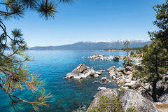 Sierra Nevada around Lake Tahoe framed with tree branches Royalty Free Stock Photos
