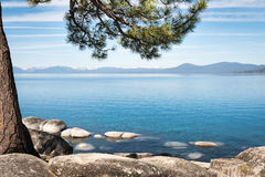 Sierra Nevada around Lake Tahoe framed with tree branches Stock Photos