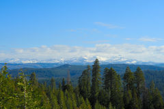 Sierra Nevada Crystal Range. Snow covered Sierra Nevada mountains as viewed across miles of open forest. Behind these mountains is Lake Tahoe Royalty Free Stock Photography