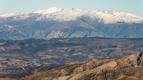 Sierra Nevada. Mountains of the sierra nevada of the city Granada, taken from the Maroma in Malaga Royalty Free Stock Photo