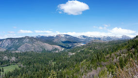 Sierra Nevada Panorama. Panoramic view of the Sierra Nevada from highway 80 Westbound past Donner Summit, California, USA, in the winter of 2017 Stock Image