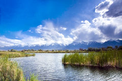 Sierra Nevada Pond. Storm clouds tumbling over the Sierra Nevada range loom over a valley pond Stock Photography