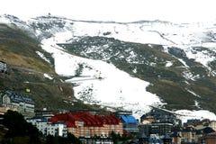 Sierra Nevada, Spain. Snowy green mountain and houses, Sierra Nevada, Spain royalty free stock photography