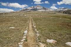 Sierra Nevada Trail. Trail across the Humphreys Basin in the Sierra Nevada Mountains with Mount Humphreys on the horizon Stock Images