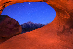 Sierra night with Mobius Arch. Arch night scene with stars at Lone Pine, California, USA Stock Image