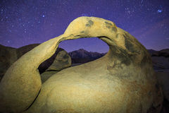 Sierra night with Mobius Arch. Arch night scene with stars at Lone Pine, California, USA Stock Photo
