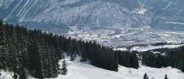 Sierre valley landscape. Scenic view of forested snow covered slopes of Sierre Valley, Switzerland Stock Photo