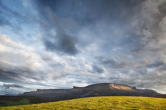 Sierrra Salvada mountains in a cloudy sunset Stock Images