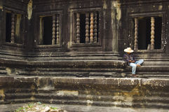 Siesta. Local teenage boy having a rest at the temples of Angkor Wat Stock Image