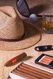 Siesta - cigar, straw hat,Scotch whiskey and golf driver on a wo Stock Image