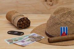 Siesta - cigars, straw hat and Cuban banknotes Royalty Free Stock Photos