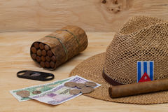 Siesta - cigars, straw hat and Cuban banknotes Stock Photos