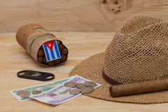 Siesta - cigars, straw hat and Cuban banknotes Stock Images