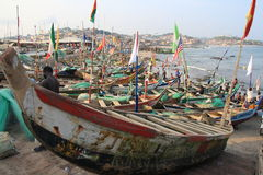 Siesta of fishermen in Cape Coast harbour, Africa stock photo