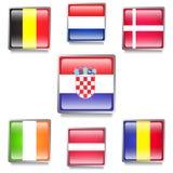 Siete banderas de países europeos hechas como botones del web Foto de archivo