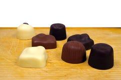 Siete chocolates Imágenes de archivo libres de regalías