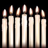 Siete velas blancas Foto de archivo libre de regalías