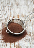 Sieve with cocoa powder Royalty Free Stock Image