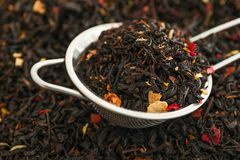 Sieve with dry black tea leaves, closeup royalty free stock images