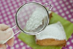 Sieve with powdered sugar Stock Images