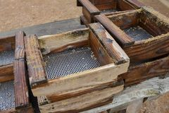 Sieve for searching gold. Mining and sifting royalty free stock images