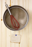 Sieve on a wooden wall Royalty Free Stock Image