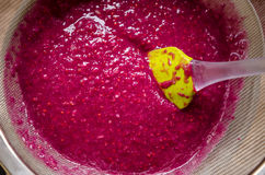 Sieving raspberry puree Royalty Free Stock Photos