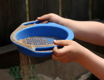 Sieving Sand Stock Photos