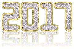 2017 siffror komponerade av ädelstenar i guld- kant på glansig vit bakgrund Arkivfoton