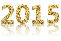 2015 siffror komponerade av små guld- stjärnor på glansig vit Royaltyfri Fotografi