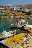 Sifnos. Boats and fishermen at the port of herronissos Royalty Free Stock Photo
