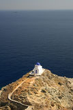 Sifnos-Cyglades-Greece. The Church of Seven Martyrs finds itself built very close to the castle on a cliff Royalty Free Stock Photography