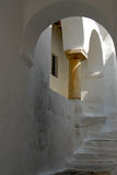 Sifnos-Cyglades-Greece. Narrow steps slated to inside the castle Royalty Free Stock Photos